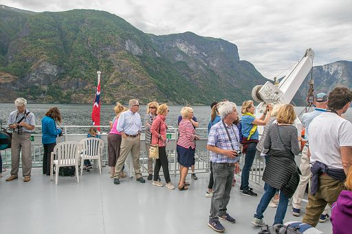 People enjoying a fjord boat ride