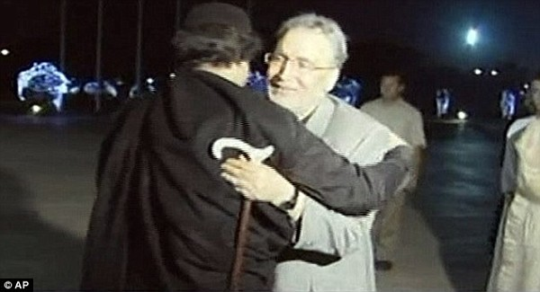 Gaddafi and bomber embrace