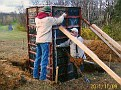 Harvey Pelley  and his son building concrete pillar.