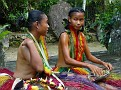 Young Ladies Talking While Weaving