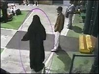 Yassin Omar, in burqa disguise, fleeing from the police.