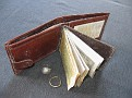 Contents of John's wallet and rings.